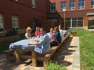 Staff eating in the garden