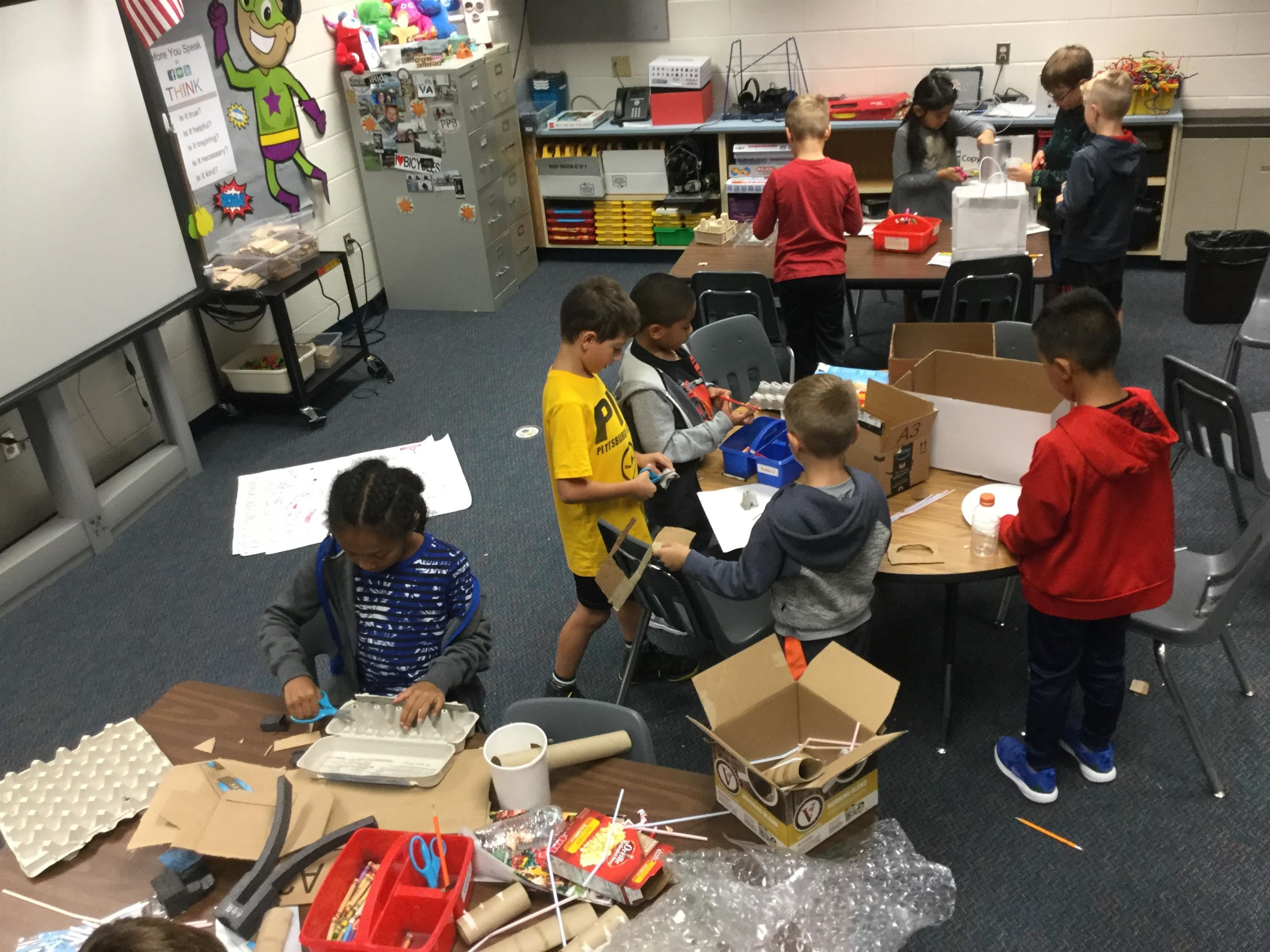 students creating cardboard arcade games