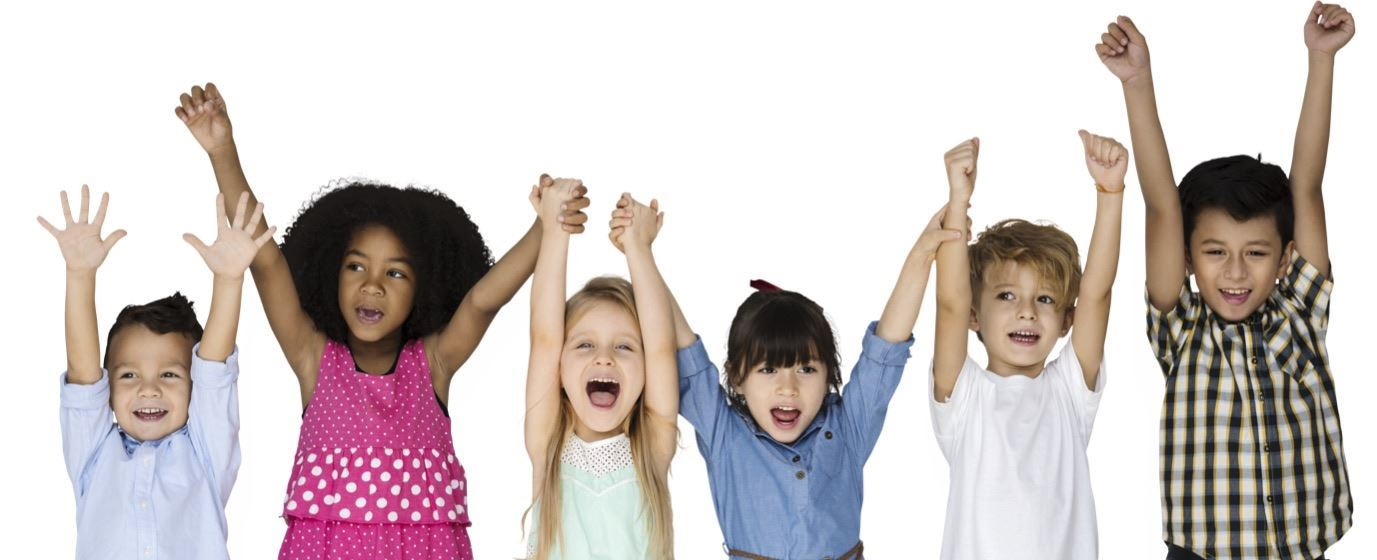 Group of children with hands in the air and happy smiles