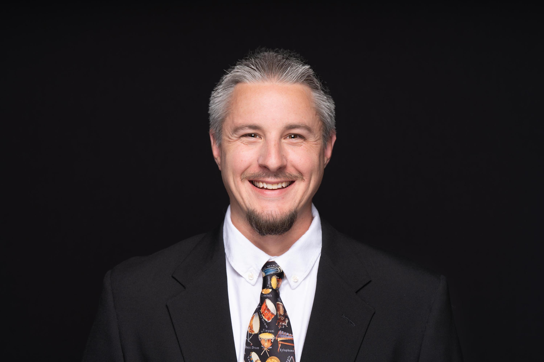 Mr. Adam Riley