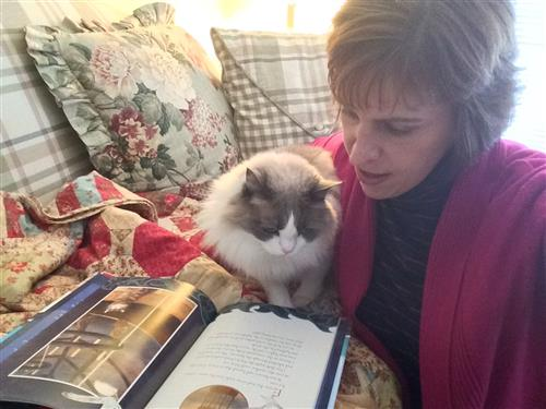 Miss Sierra reading with her kitty.