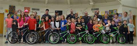 Students, teachers and volunteers with bikes that have been built