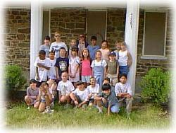 students in front of farm house