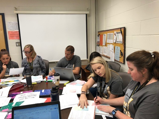 Teachers and admin collaborate in lab sites