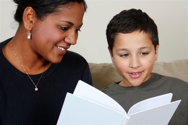 woman and boy reading book
