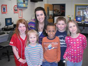 Cedar Art Teacher with students