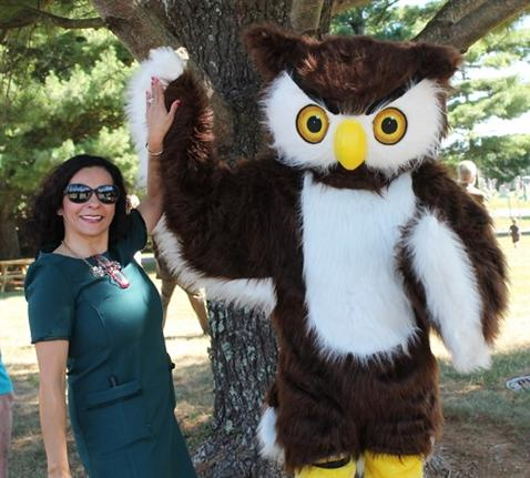 Principal and Horned Owl Mascot giving a high five